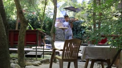 Waiter brings tea and pitta bread to visitors of restaurant, Istanbul, Turkey Stock Footage