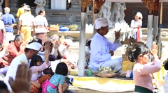 Balinese families pray in sacred springs water temple. Bali, Indonesia Stock Footage
