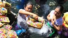 People come to sacred springs water temple Tirta Empul in Bali, Indonesia Stock Footage