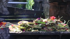 Offerings to gods in Bali with flowers, money and aromatic sticks,  Indonesia - stock footage