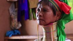 Portrait Padaung Tribal woman poses for a photo in Inle lake, Myanmar, Burma Stock Footage