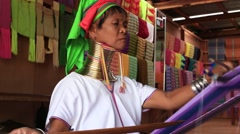 Portrait Padaung Tribal woman poses for a photo in Inle lake, Myanmar, Burma - stock footage