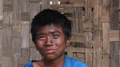 Portrait grimy boy working in the street garage. Myanmar, Burma Stock Footage