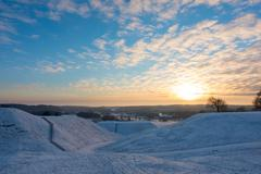 Winter landscape and sunset Stock Photos
