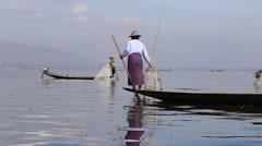 Fisherman on boat catching fish in Inle lake, Myanmar, Burma - stock footage