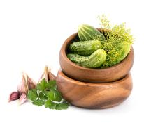 Preparation of cucumbers and greenery is to canning - stock photo