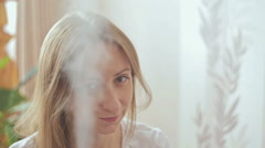 Humidifier and woman Stock Footage