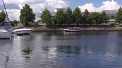 Boats float past the yacht club, Riga, Latvia Stock Footage