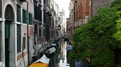 Venice Italy neighborhood apartments along beautiful narrow canal Stock Footage