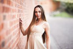 Beautiful sexy girl with long hair and dress perfect shape tanned body possing - stock photo