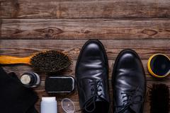 Shoe wax, brush and boot - stock photo