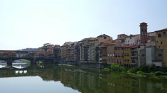 Time lapse with Arno River and Ponte Vecchio bridge in Florence, Italy - stock footage