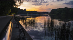 4K hyperlapse of summer evening park, river and pedestrian embankment Stock Footage