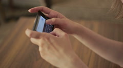 Woman typing text messages on smart phone Stock Footage