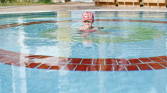 little girl swimming in the pool - stock footage