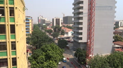 Luanda, Angola High angle view of city traffic on streets with cars and people - stock footage