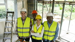 4K Portrait smiling team of architects & engineers at construction site Stock Footage