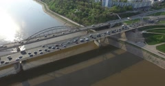 Flying over the bridge across the river. Entry into the city Stock Footage