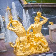 Gold-plated statue-fountain - stock photo