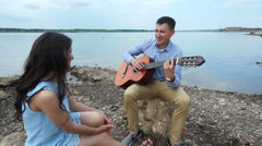 Footage Of Friends Relaxing With Guitar And Drinks At A Camp Site. Stock Footage