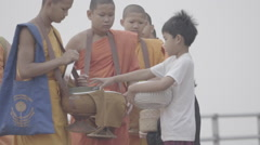 To give food to the monk Stock Footage