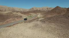 Car crosses the desert. Aerial shot Stock Footage