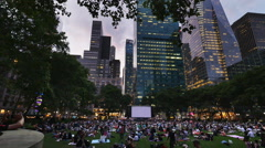 People Wait in Bryant Park for a Movie to Play on the Big Screen Stock Footage