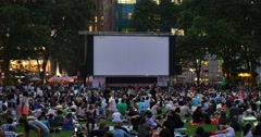 People Wait for a Movie in Bryant Park in the Evening Stock Footage