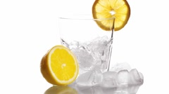 Mixing  Cocktail In A Glass Adding Ice Tonic Water And Slice Of Lime Stock Footage