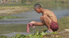 Man washing in river,Chitwan,Nepal Stock Footage