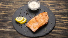 Fish steak on a wooden table Stock Footage
