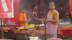 Man barbeque on festival,Chitwan,Nepal Stock Footage