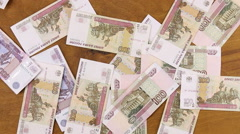 Rubles banknotes falling down to wooden table Stock Footage