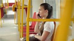 Woman talk to smartphone in the public transport, girl talking on the phone - stock footage