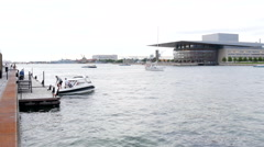 A small boat at the quay in Copenhagen in front of the Opera House - stock footage