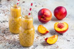 Summer smoothie with nectarine, orange juice, chia seeds, honey, horizontal - stock photo