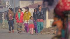 Girls walking early morning in village road,Chitwan,Nepal - stock footage
