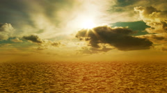 Orange warm tone sea, ocean with waves, sky, sun light ray and clouds. - stock footage