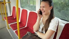 Woman talk to cell phone in the public transport, girl talking on the phone - stock footage