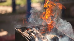 Burning firewood outdoors for barbecues and grill Stock Footage