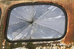 Old truck shattered window - stock photo