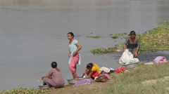 Women washing clothes at river bed,Chitwan,Nepal Stock Footage
