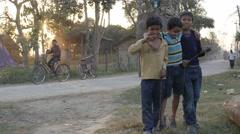 Happy kids on road whith elephants on road,Chitwan,Nepal - stock footage