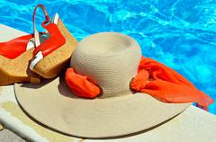 Woman beach hat,  red sandals and starfish. - stock photo