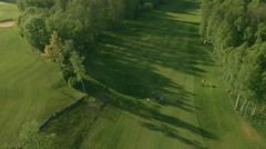 Aerial Shot. Group of People are Playing Golf on Field in Sunny Day. - stock footage