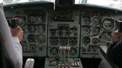 Two pilots fly a plane, sitting at the controls Stock Footage