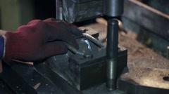 Worker at manufacture workshop operating metal press machine Stock Footage