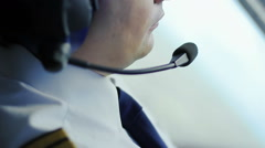 Attentive pilot navigating airplane, transmitting information to dispatcher - stock footage