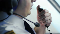 Airplane in turbulence, chief pilot reporting situation to flight dispatcher - stock footage