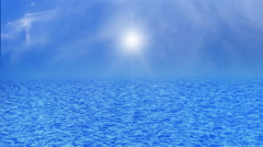 Blue sea, ocean with waves and clear blue sky sun light ray and clouds. Stock Footage